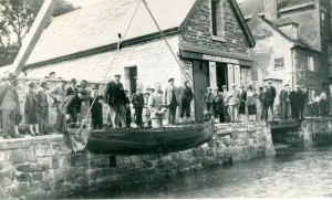 Launch of the first Falcon, 'Sparrowhawk', with the owner,  Dr Llewellyn Pridham on board and  Mr Bussell, the designer and builder supervising, 1927