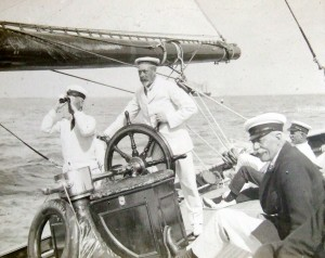 King George V racing his J-Class yacht Brittannia in Weymouth Bay.  Mr Bussell is in the right  foreground.