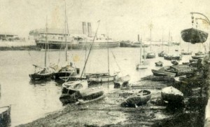Cosens small slip area 1905. GWR Mailboat Reindeer with new theatre being built in background